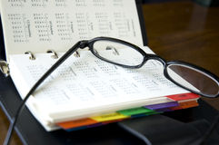 Personal Organizer With Eyeglasses Royalty Free Stock Image