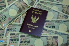 Personal passport of the Thai people with a crimson cover. Put o. Personal passport of the Thai people with a crimson cover royalty free stock images