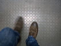 Personal perspective. Of legs and shoes Royalty Free Stock Image