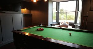Games Room with a Pool Table. Personal perspective, walking into the games room in a house and panning around to show the full length pool table stock video footage