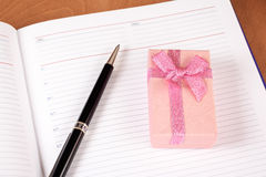 Personal planner with gift box and pen Stock Photography