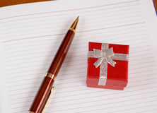 Personal planner with gift box and pen. Selective focus Royalty Free Stock Photos