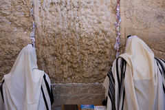 Personal prays. Praying men in Western Wall in Jerusalem Royalty Free Stock Images