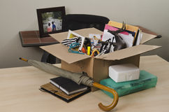 Personal property in carton on desk Royalty Free Stock Image