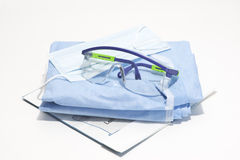 Personal Protection. Gloves, mask, gown and safety glasses for personal protection during surgical procedures Royalty Free Stock Image