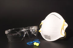 Personal Protective Equipment. Dust mask, ear plugs and safety glasses personal protective equipment Royalty Free Stock Image
