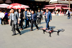 Personal quadcopter drone. SHANGHAI, CN - MAR 16 2015:Personal quadcopter drone demonstration in Shanghai, China.These quadcopter is recreational and commercial royalty free stock image