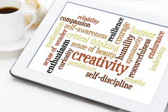 Personal qualities word cloud. Creativity, self-discipline and other personal qualities - a word cloud on a digital tablet with cup of coffee stock images