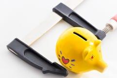 Personal savings pressure Royalty Free Stock Image