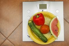Personal scale in the bathroom. The concept of diet and weight control. Royalty Free Stock Images