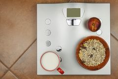 Personal scale in the bathroom. The concept of diet and weight control. Royalty Free Stock Photography