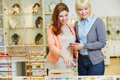 Personal Shopper advising woman Royalty Free Stock Images