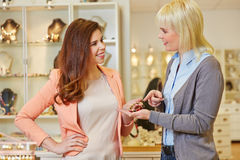 Personal Shopper with woman at. Personal Shopper with women at jeweler buying jewelry stock image