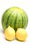 Personal size watermelon and two lemons Royalty Free Stock Photos