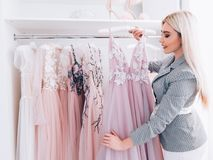 Personal style fashion shopping assistant boutique. Personal style fashion consultant. Shopping assistant working in luxury boutique with designer evening stock photos