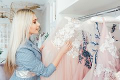 Personal style fashion shopping assistant showroom. Personal style fashion consultant. Shopping assistant working in luxury showroom with designer evening stock image
