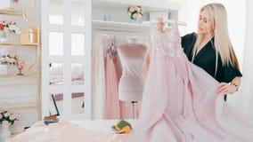 Personal stylist fashion designer bespoke service. Personal stylist. Bespoke service. Custom clothing studio. Female fashion designer working in luxury showroom royalty free stock photos