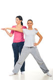 Personal trainer assist woman at fitness Stock Images