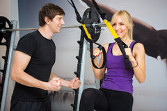 Personal trainer assist woman Stock Photo