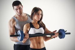Personal trainer assisting a client Stock Image