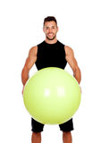 Personal trainer with a big ball Stock Photo