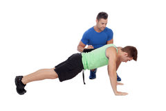 Personal trainer and boy making push-ups Royalty Free Stock Photos