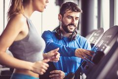Girl jogging on treadmill. royalty free stock images