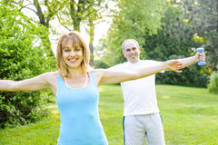 Personal trainer with client exercising outside Royalty Free Stock Images