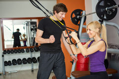 Personal trainer with client. At gym Royalty Free Stock Photo