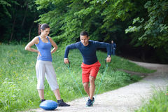 Personal trainer demonstrating a shoulder exercise Stock Photo