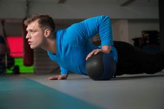 Personal Trainer Doing Push-ups With Ball royalty free stock images