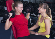 Personal trainer with dumb bell Royalty Free Stock Photography