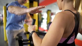 Personal trainer encouraging client and inspiring her to continue doing exercise royalty free stock image