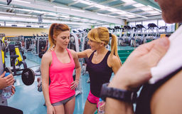 Personal trainer encouraging to sad woman after Royalty Free Stock Photos