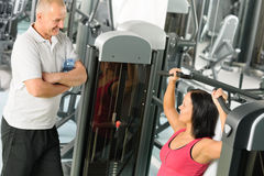 Personal trainer at fitness center show exercise Stock Photos
