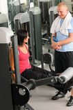 Personal trainer at fitness center show exercise Royalty Free Stock Images