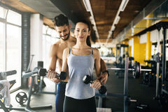 Personal trainer giving instructions in gym Royalty Free Stock Photo