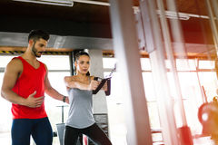 Personal trainer giving instructions in gym royalty free stock photography