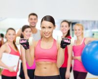 Personal trainer with group in gym Stock Images