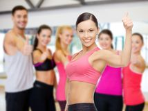 Personal trainer with group in gym Stock Photos