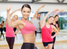 Personal trainer with group in gym Stock Image