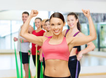 Personal trainer with group in gym Royalty Free Stock Image