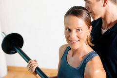 Personal Trainer in gym Stock Photos