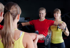 Personal Trainer in Gym Royalty Free Stock Image