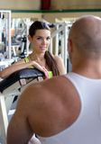 Personal Trainer in gym Stock Photography