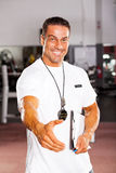 Personal trainer hand shake. Friendly male personal trainer hand shake Royalty Free Stock Photography
