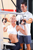 Personal trainer helping client Stock Photos