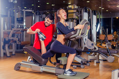 Personal trainer helping woman working with lunges, leg coaching, smile, laugh, joke . Personal trainer helping women working with lunges, leg coaching, smile Royalty Free Stock Images