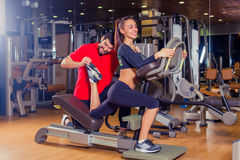 Personal trainer helping woman working with lunges, leg coaching, smile, laugh, joke . Stock Photos