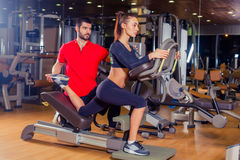 Personal trainer helping woman working with lunges, leg coaching Royalty Free Stock Photo
